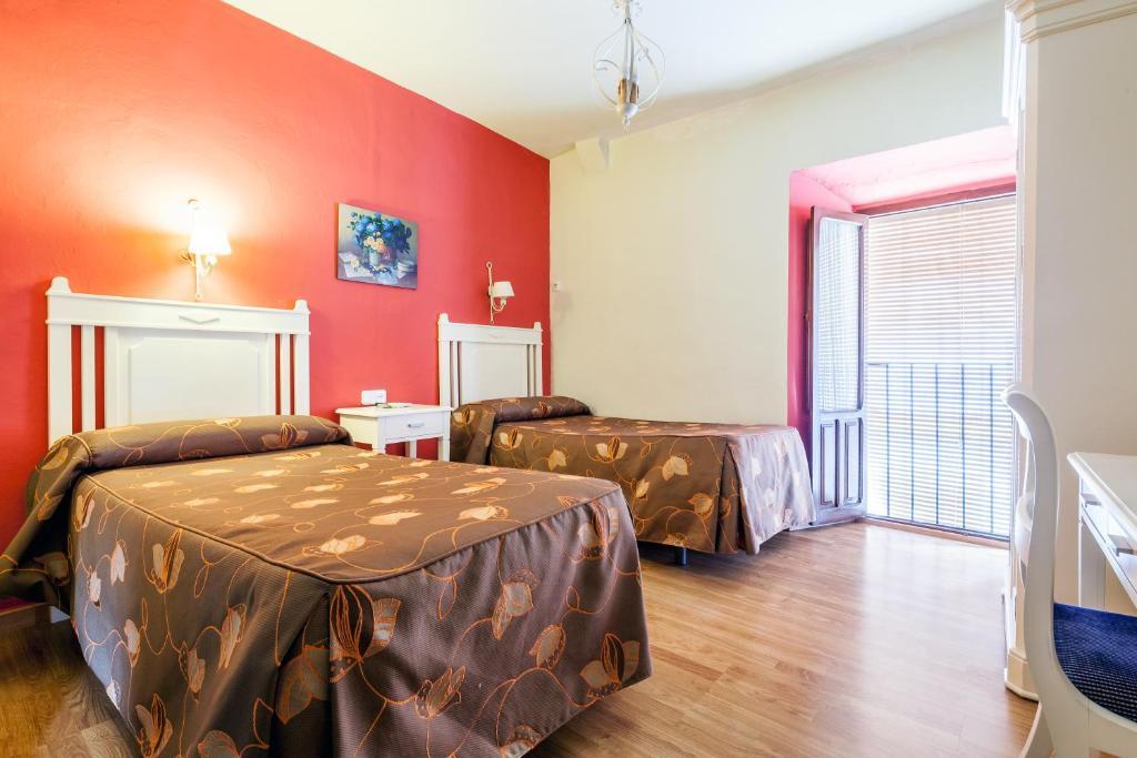 Llit o llits en una habitació de Hostal El Caballo Blanco