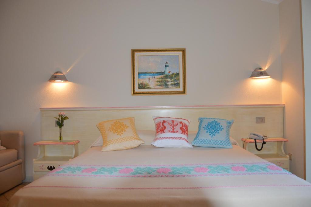 A bed or beds in a room at Hotel La Palma