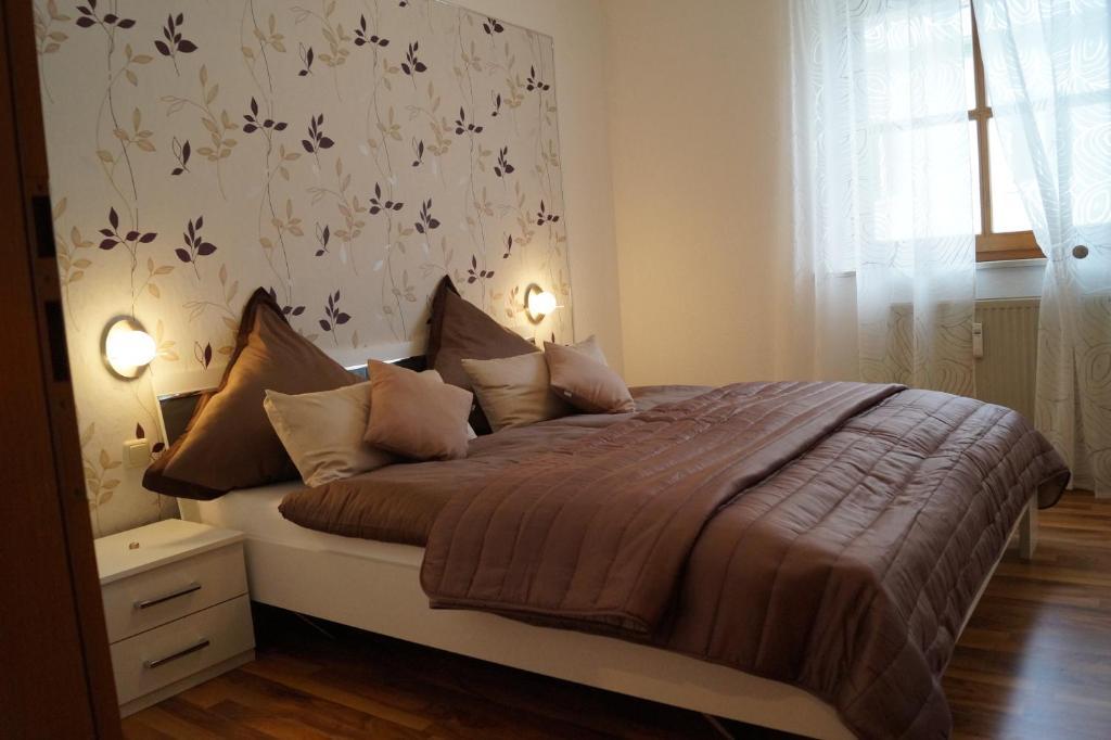 Ein Bett oder Betten in einem Zimmer der Unterkunft Altstadtinsel-Regensburg