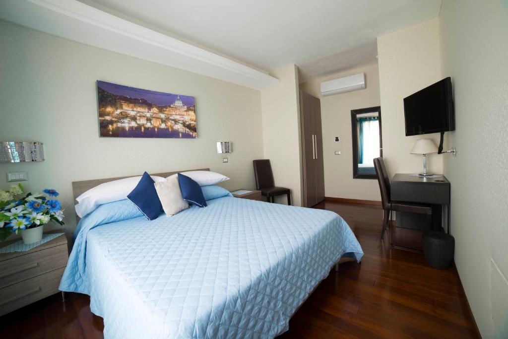 Een bed of bedden in een kamer bij Di Fronte alla Cupola