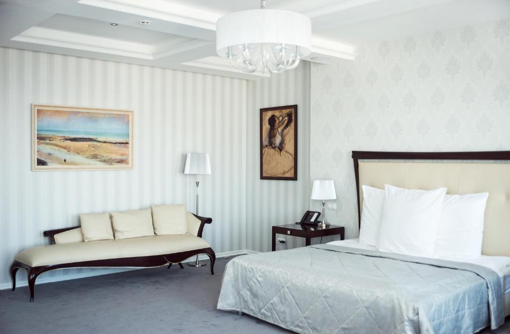 Кровать или кровати в номере Ost West Club