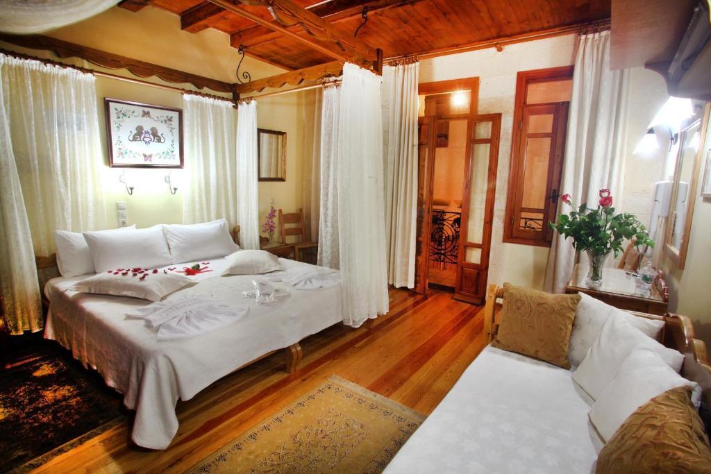 Ein Bett oder Betten in einem Zimmer der Unterkunft Palazzo di Pietro