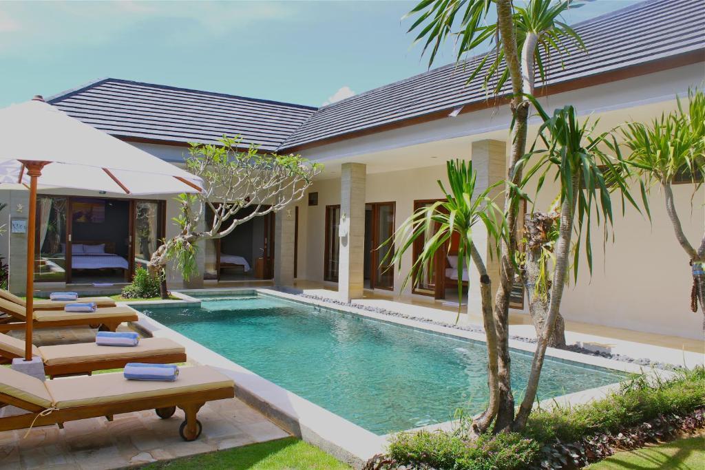 The swimming pool at or near The Daun Bali