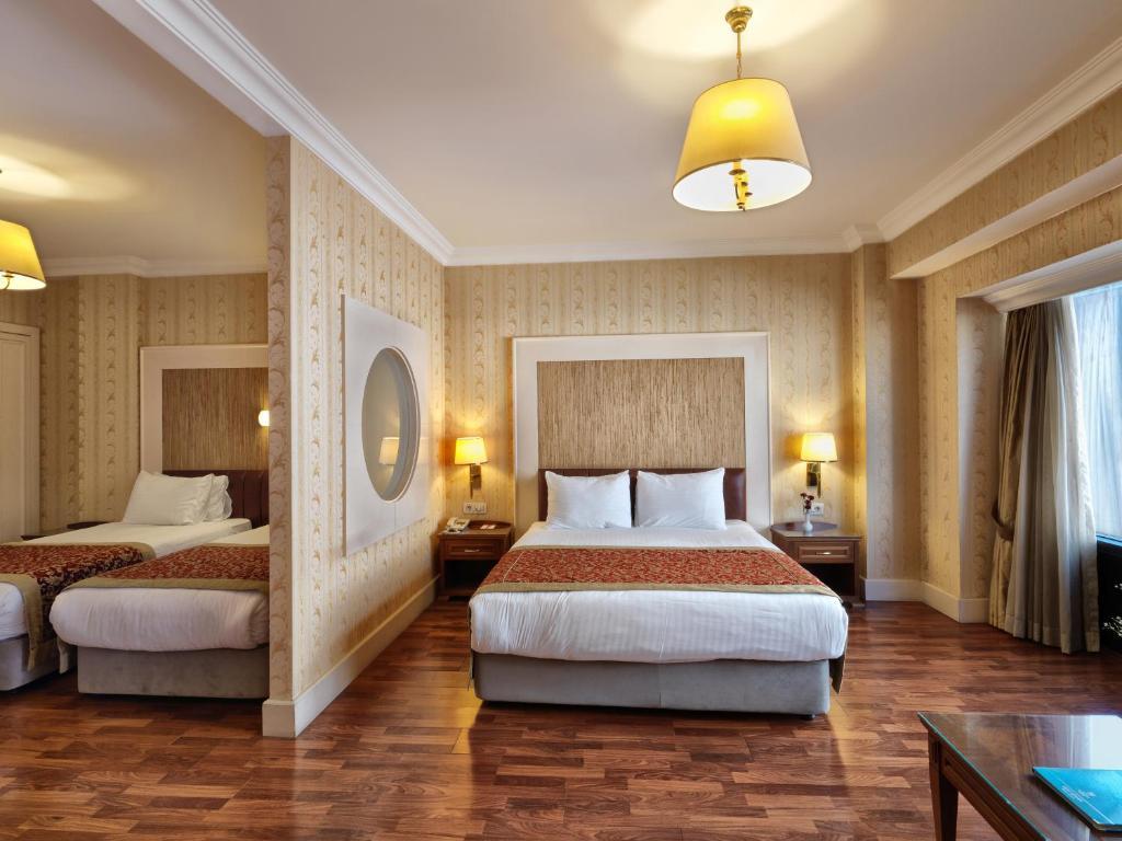 Cama o camas de una habitación en Taksim Metropark Hotel