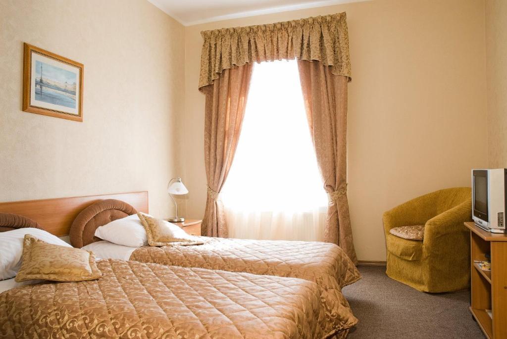 Кровать или кровати в номере Nevsky Guest House