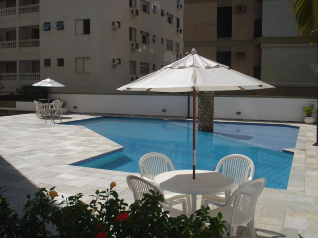 The swimming pool at or near Apartamento 3 Quartos Guarujá