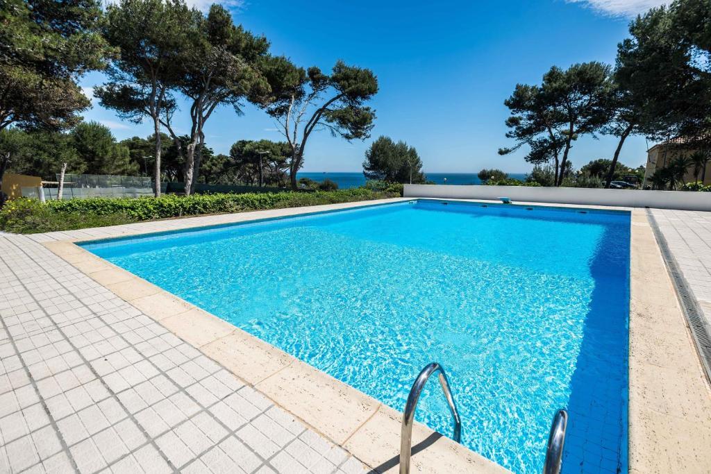 The swimming pool at or near Guincho Beach Villa