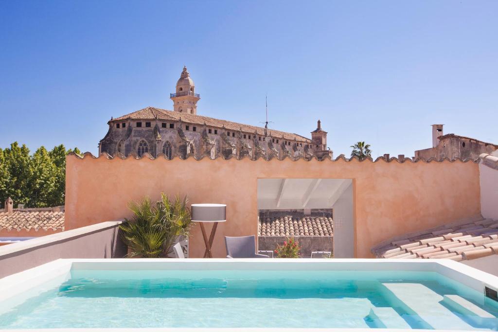 The swimming pool at or near Boutique Hotel Posada Terra Santa