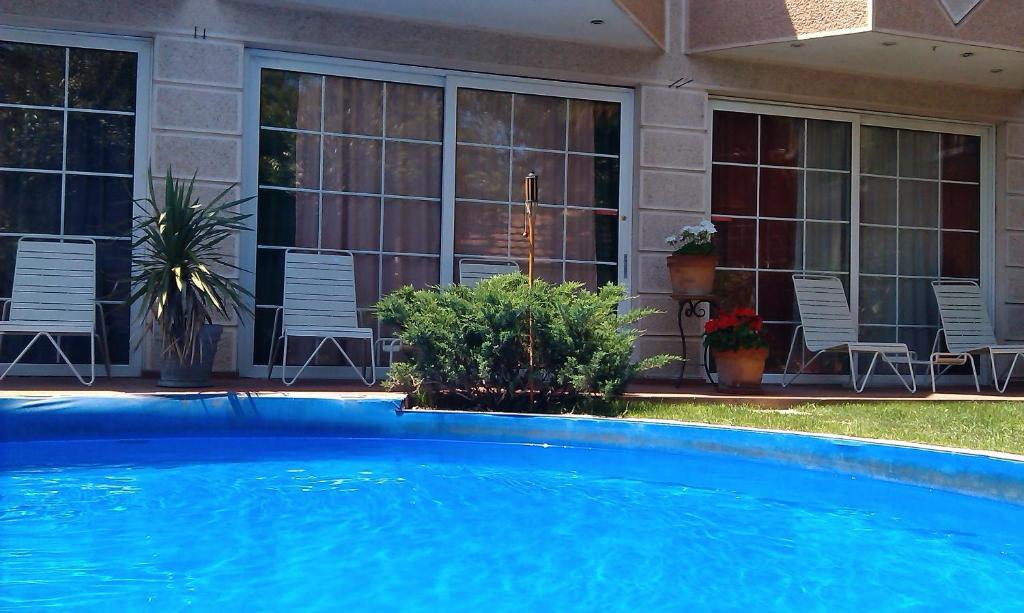 The swimming pool at or near Aloha Luxury Apartments