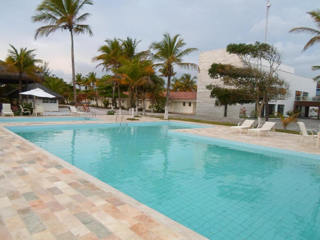 Hotel Abrolhos tesisinde veya buraya yakın yüzme havuzu