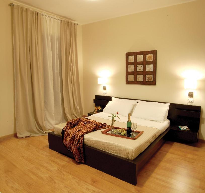 Un ou plusieurs lits dans un hébergement de l'établissement Bella Cagliari B&B