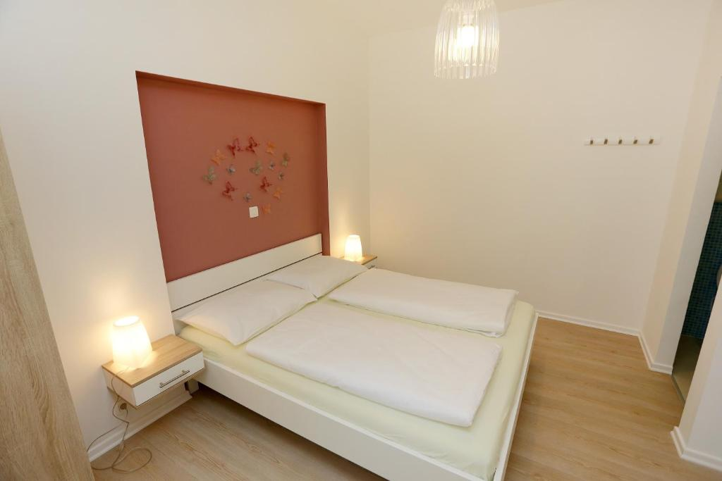 A bed or beds in a room at Zadar Street Apartments and Room