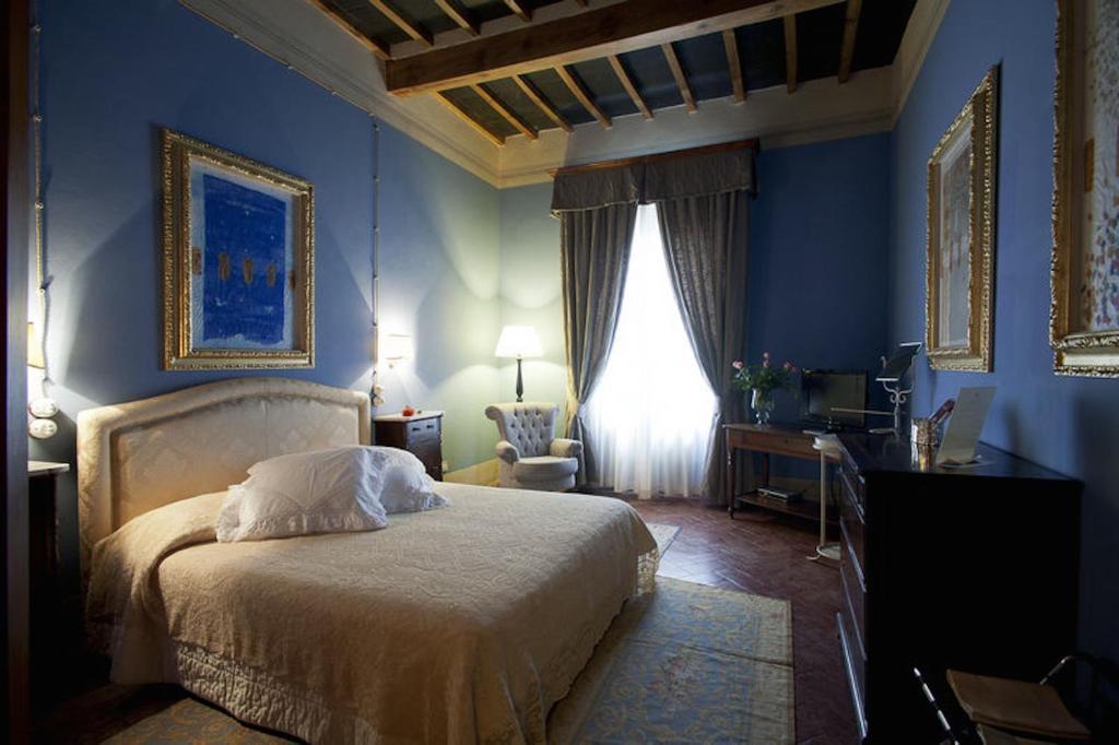Letto o letti in una camera di Residenza Palazzo Visdomini