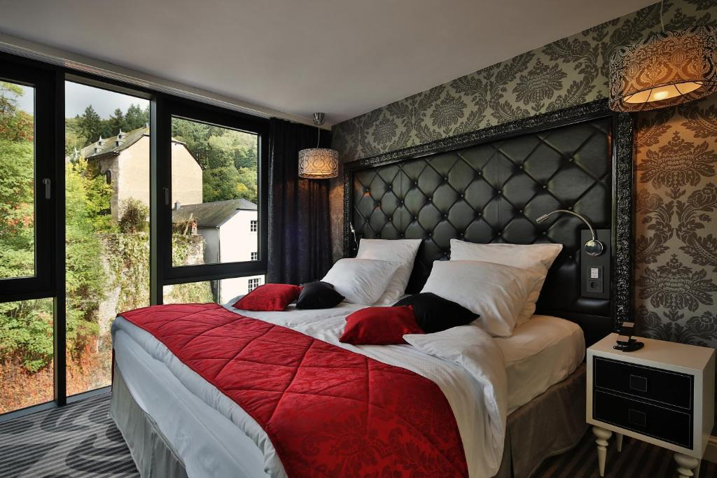 A bed or beds in a room at Le Clervaux Boutique