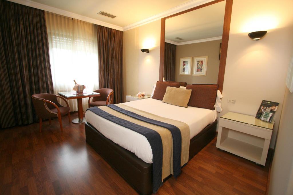 Cama o camas de una habitación en Motel Aeropuerto