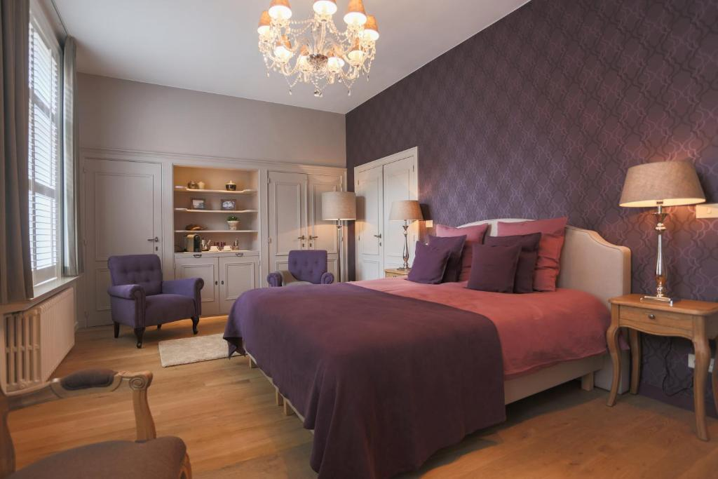 A bed or beds in a room at B&B De Bornedrager