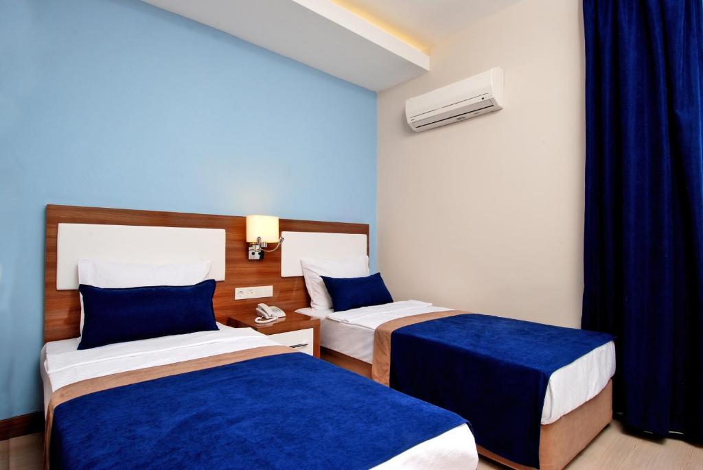 Кровать или кровати в номере Kleopatra Ramira Hotel - All Inclusive