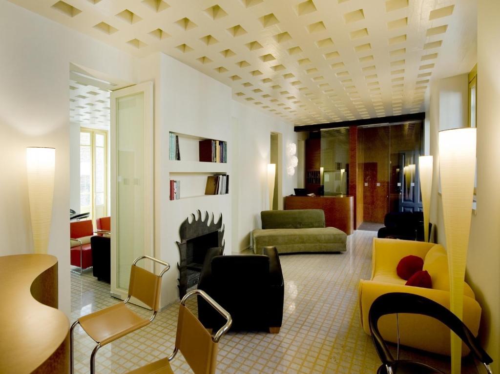 Een zitgedeelte bij Petronilla - Hotel In Bergamo