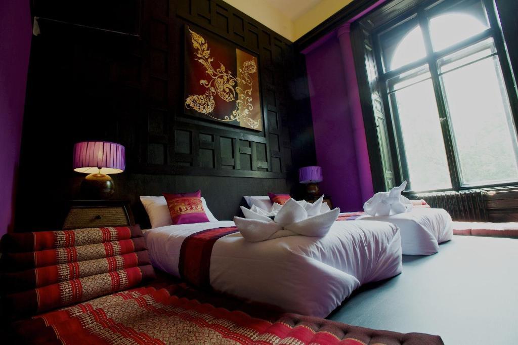 Lova arba lovos apgyvendinimo įstaigoje Andrassy Thai Hotel
