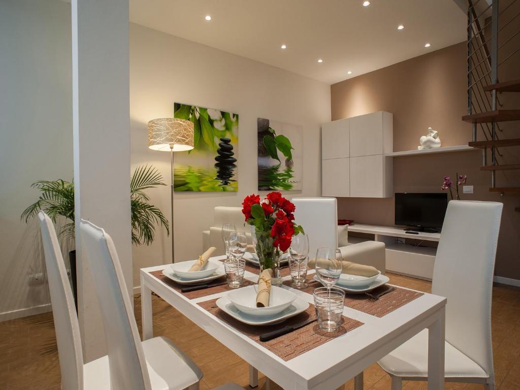Een restaurant of ander eetgelegenheid bij La Farina Apartments