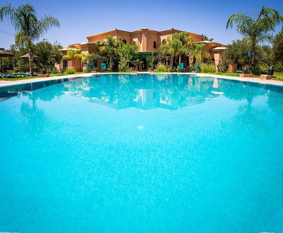 The swimming pool at or near Las Palmeras