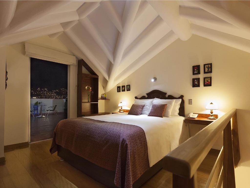 Cama o camas de una habitación en Tandapata Boutique Hotel