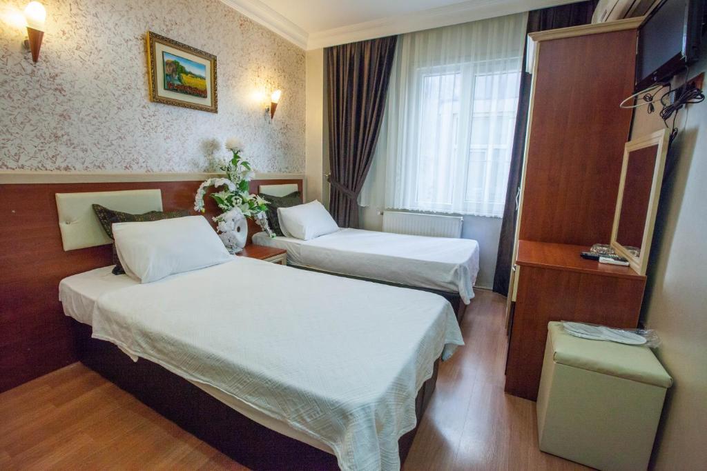 Кровать или кровати в номере Grand Hotel Palmiye