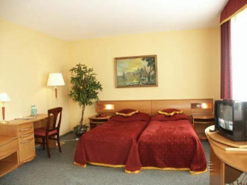Кровать или кровати в номере Hotel Żuławy