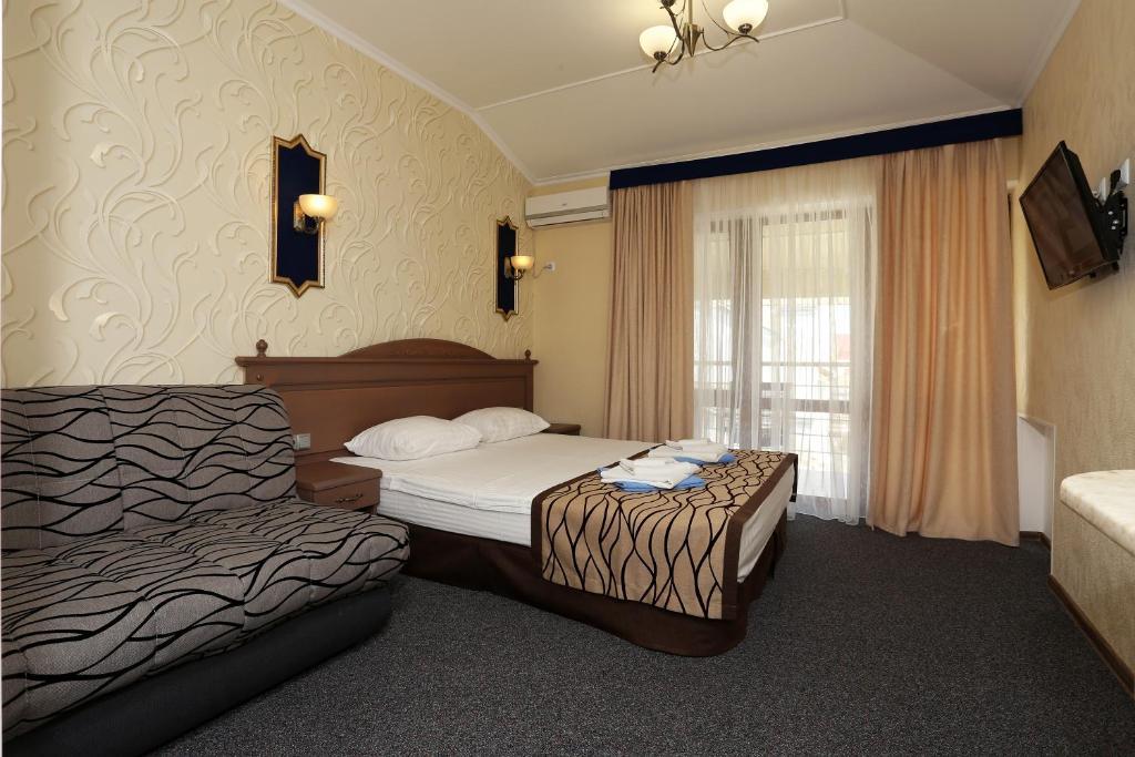 Кровать или кровати в номере Гостевой Дом Oriental