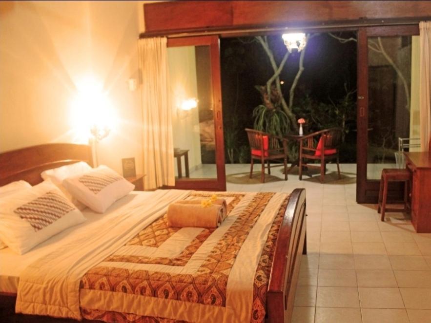 Cama ou camas em um quarto em Puri Wisnu Bungalow