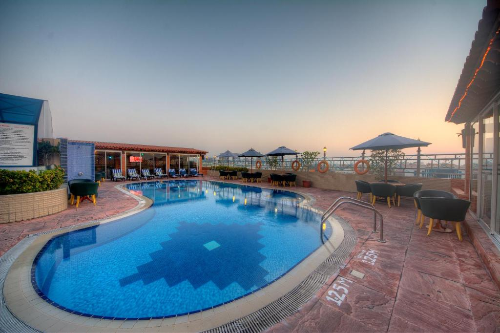 The swimming pool at or close to Fortune Grand Hotel