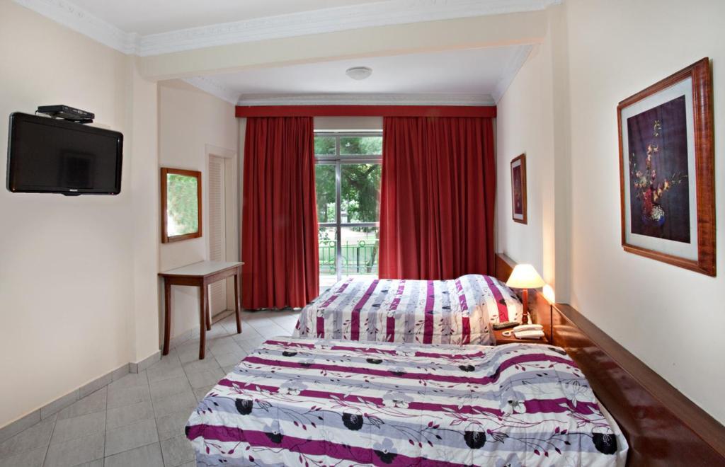 Cama ou camas em um quarto em Hotel Inglês