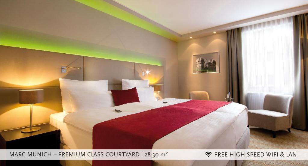 מיטה או מיטות בחדר ב-Marc München