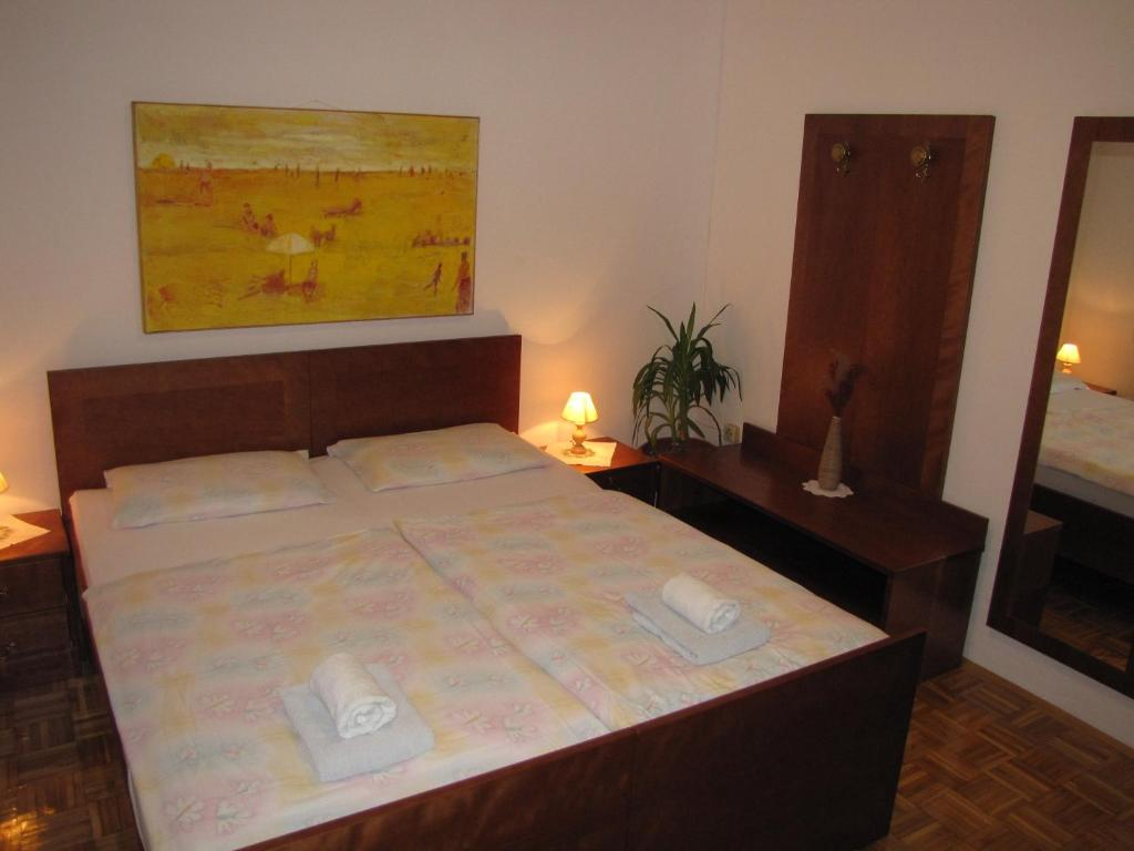 Postelja oz. postelje v sobi nastanitve Guesthouse Zorko Gostilna Domen