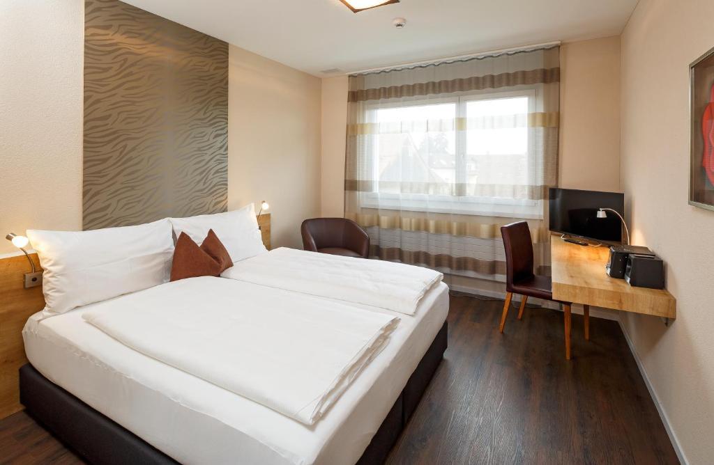 Ein Bett oder Betten in einem Zimmer der Unterkunft Villmergen Swiss Quality Hotel