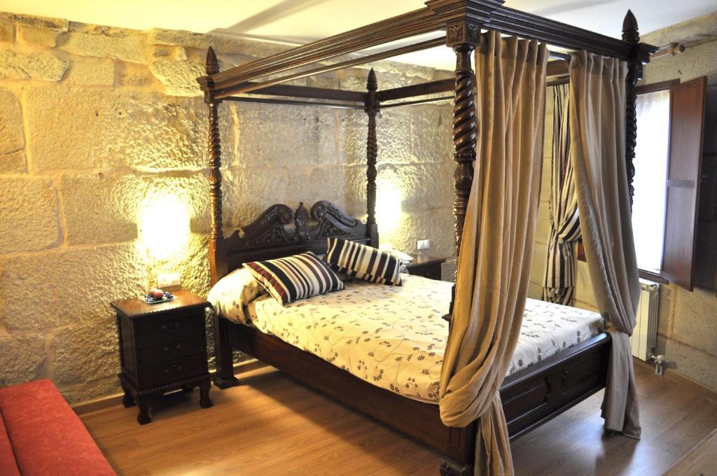 เตียงในห้องที่ Hotel Boa Vila
