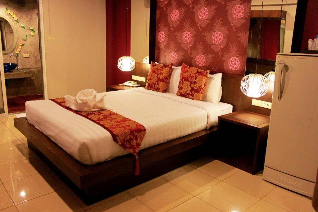 A bed or beds in a room at Chana Place