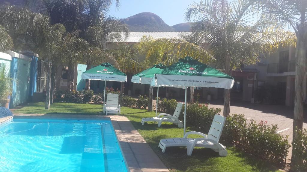 The swimming pool at or near Palm Valley Inn