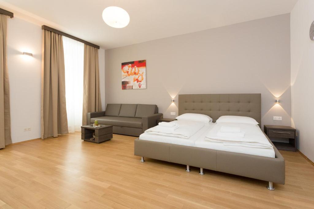 Ein Bett oder Betten in einem Zimmer der Unterkunft Yourapartment 1030