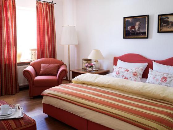 Ein Bett oder Betten in einem Zimmer der Unterkunft Alte Posthalterei Zorneding
