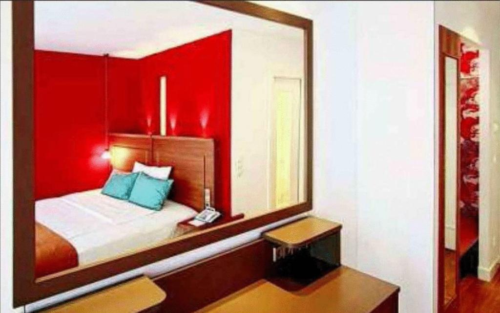 Ein Bett oder Betten in einem Zimmer der Unterkunft Gasthof-Hotel Zum Ochsen