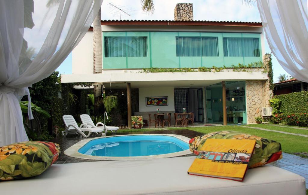 A piscina localizada em Pousada Palmeira Imperial ou nos arredores