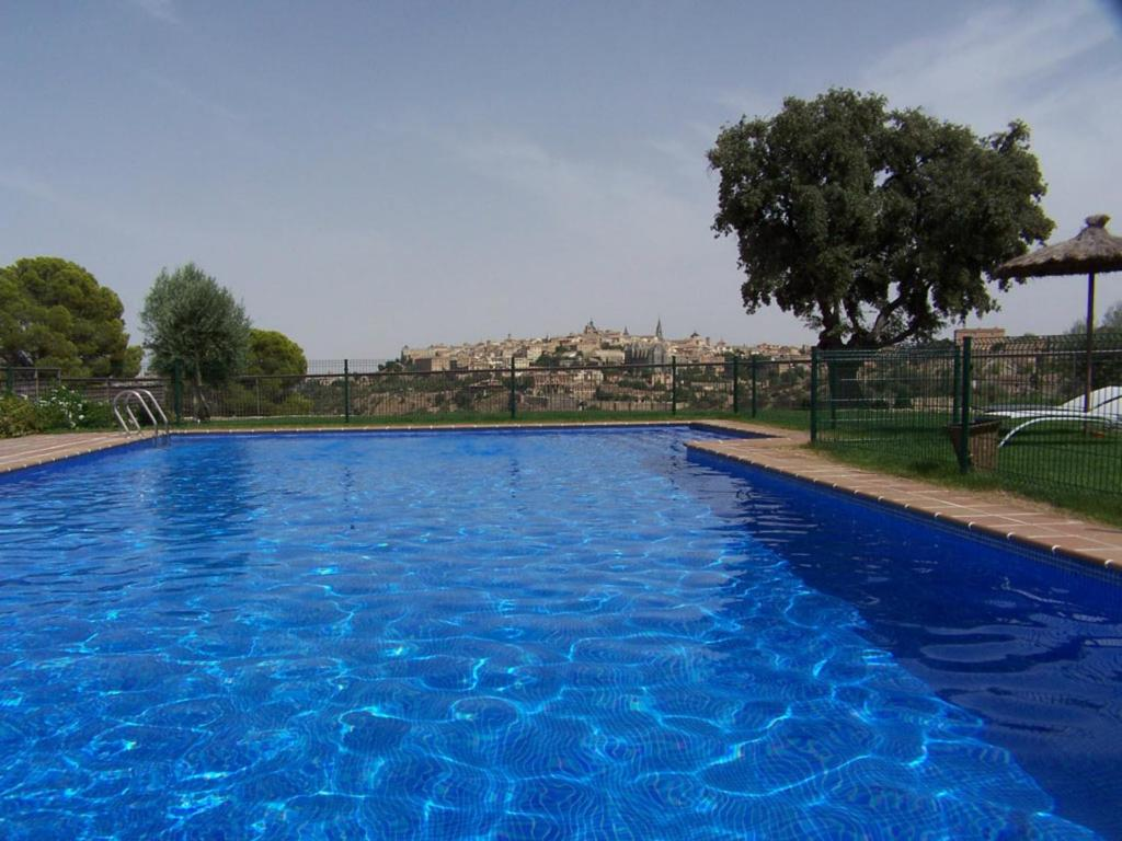 The swimming pool at or near Hotel Cigarral el Bosque