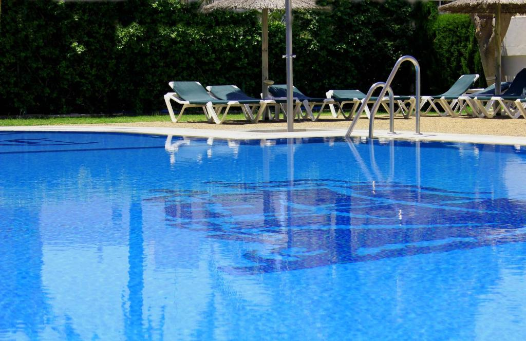 The swimming pool at or close to Hotel Caribe