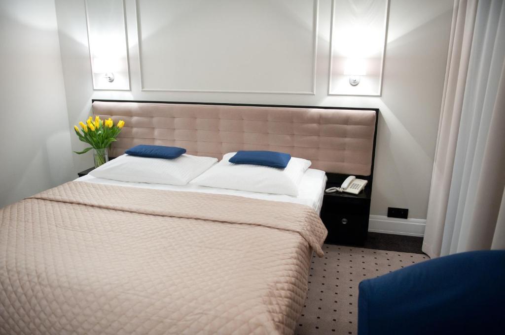 Łóżko lub łóżka w pokoju w obiekcie Hotel Focus