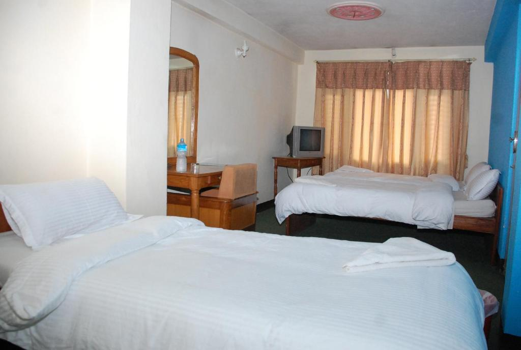 A bed or beds in a room at Holyland Guest House