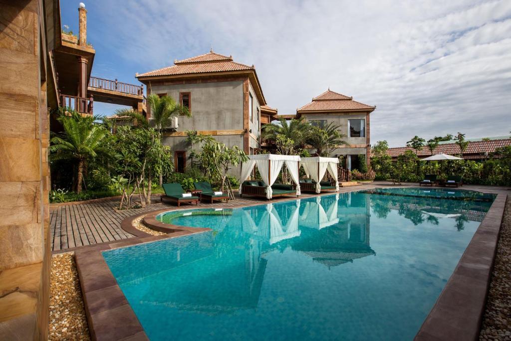 Piscina a Model Angkor Resort o a prop