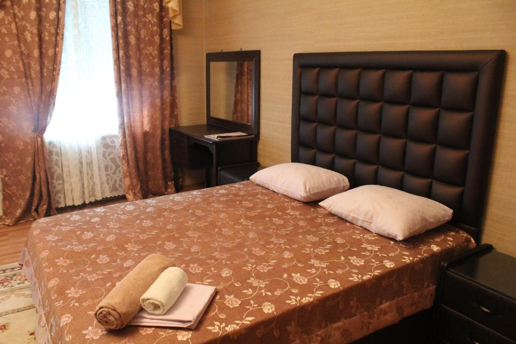 Кровать или кровати в номере Гостиница Петровск