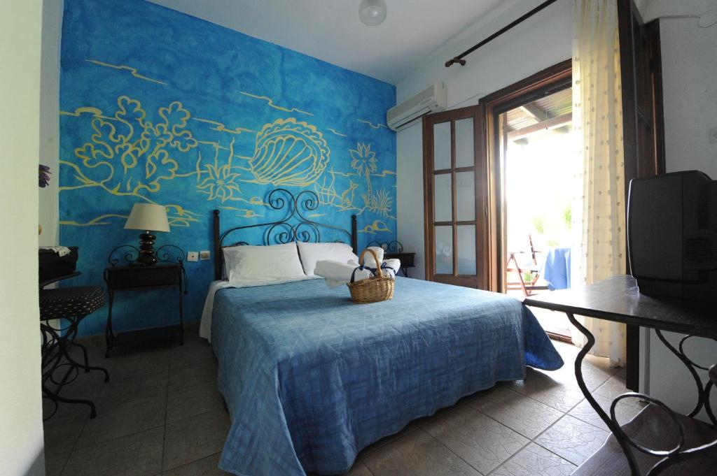 A bed or beds in a room at Thalassa Hotel