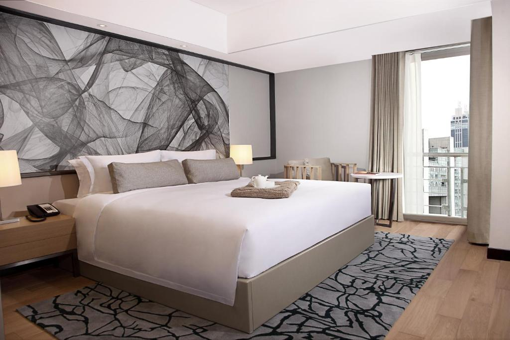 A bed or beds in a room at Fraser Residence Shanghai